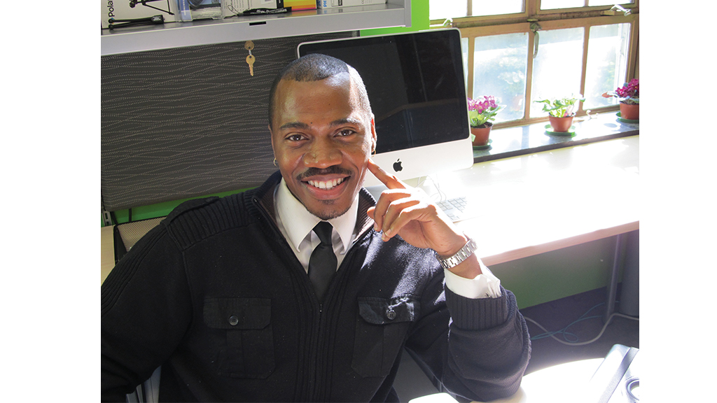 kirkland smiles from his desk