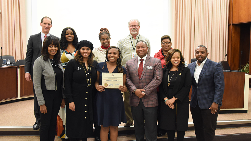 a group picture of the shelby county school board with a student