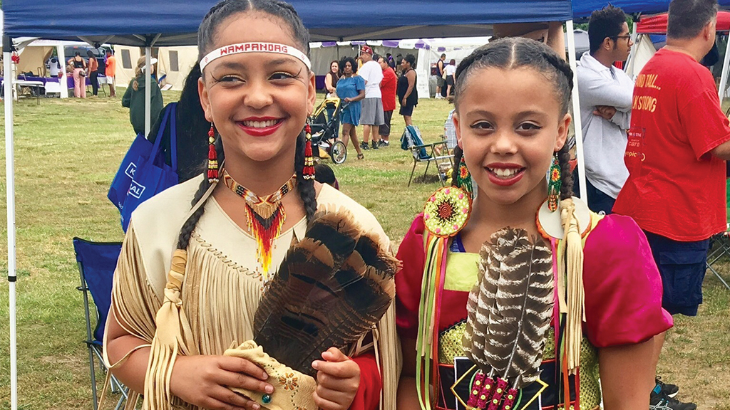 young members of the Mashpee Wampanoag Tribe in traditional outfits