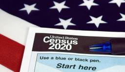 A census form on top of an american flag