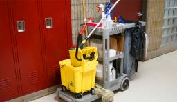 A janitorial station in a hallway in front of lockers